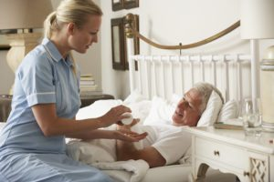 bigstock-Nurse-Giving-Senior-Male-Medic-92384702-300x200.jpg
