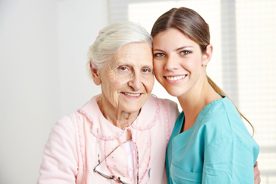 bigstock-Smiling-caregiver-embracing-ha-54611003_preview-1.jpeg