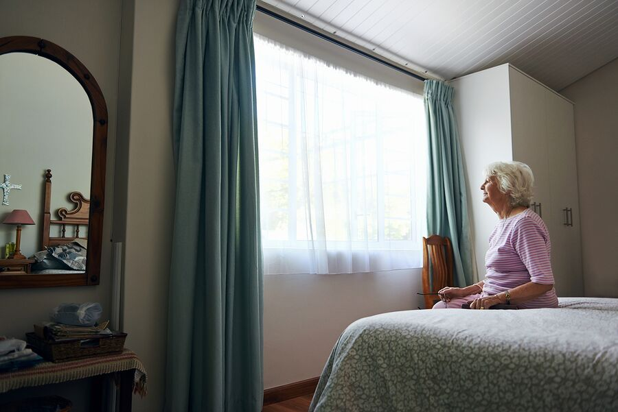 bigstock-A-depressed-elderly-widow-sitt-64804489_preview.jpeg