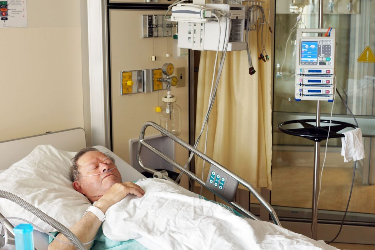 bigstock-Senior-Man-In-Hospital-Bed-66031342_preview-1200x800.jpeg