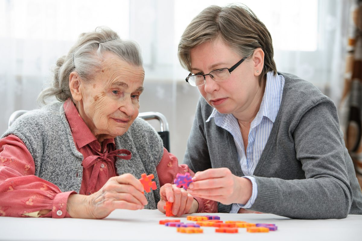 LARGE-bigstock-Elder-care-nurse-playing-jigsa-74599309-1200x800.jpg